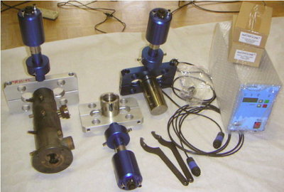 Range of components for ultrasonically-assisted plastic extrusion using clamp-on ultrasonic system